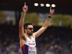 Great Britain's Martyn Rooney celebrates his victory in the Men's 400m final during the European Athletics Championships at the Letzigrund stadium in Zurich on August 15, 2014