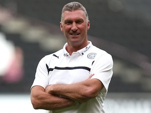 Leicester City manager Nigel Pearson looks on as the players warm up prior to the Pre-Season Friendly match between MK Dons and Leicester City on August 4, 2014