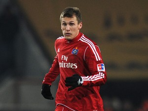Hamburg's midfielder Robert Tesche plays the ball during the German first division Bundesliga football match 1.FC Cologne vs Hamburger SV in the German city of Cologne on February 12, 2012