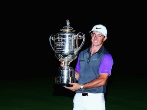 Northern Ireland's Rory McIlroy poses with the Wanamaker Trophy after winning his second US PGA title at Valhalla Golf Club on August 10, 2014