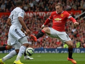 New Man Utd captain Wayne Rooney in action against Swansea on August 16, 2014