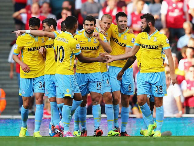 Crystal Palace players surround 'Big' Brede Hangeland after he scores their opener against Arsenal on August 16, 2014