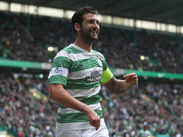 Charlie Mulgrew of Celtic celebrates after he scores during the Scottish Premiership League Match between Celtic and Dundee United, at Celtic Park on August 16, 2014