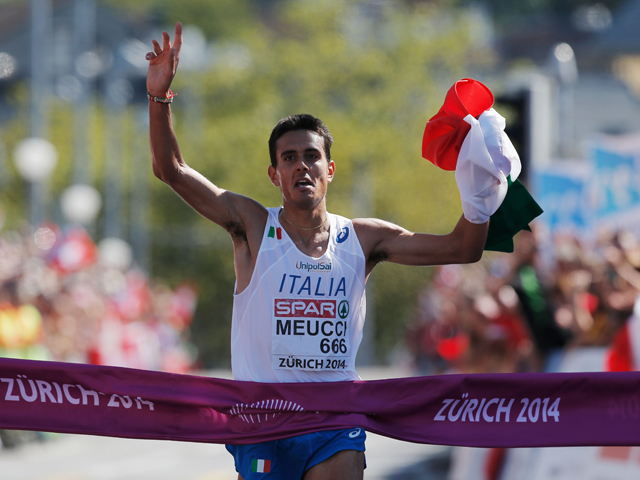 Daniele Meucci of Italy celebrates as he wins gold in the Men's Marathon during day six of the 22nd European Athletics Championships on the road race course on August 17, 2014