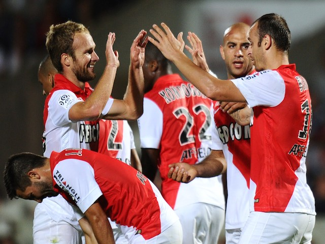 Monaco's forward Dimitar Berbatov (R) celebrates with teammates after scoring a goal during the French L1 football match between Bordeaux (FCGB) and Monaco (ASM) on August 17, 2014