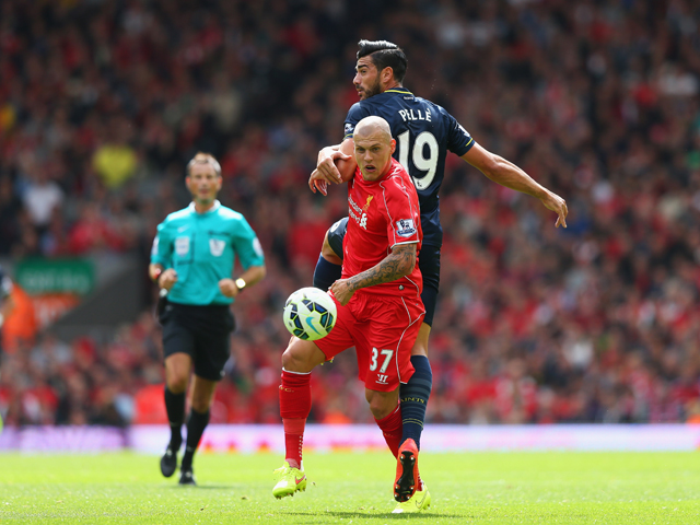 Martin Skrtel of Liverpool challenges Graziano Pelle of Southampton during the Barclays Premier League match between Liverpool and Southampton at Anfield on August 17, 2014