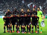 Besiktas' team players pose prior to the UEFA Champions League play-off football match Besiktas vs Arsenal at Ataturk Olympic Stadium on August 19, 2014