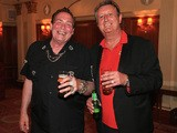 Bobby George and Eric Bristow, both former darts players, are pictured during the Pound 4 Pound Charity fundraiser for Fight4change on May 7, 2014