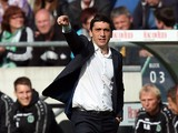 Hanover's coach Tayfun Korkut gestures during the German first division Bundesliga football match Hannover 96 v FC Schalke 04, at HDI-Arena in Hanover, Germany on August 23, 2014