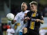 Hull's player David Meyler and Lokeren's player Alexander Scholz vie for the ball during the Europa League play-off football match between Sporting Lokeren and Hull City AFC, on August 22, 2014