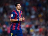 Luis Suarez of FC Barcelona looks on