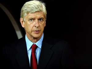 Arsenal's manager Arsene Wenger waits for the begining of the UEFA Champions League play-off football match Besiktas vs Arsenal at Ataturk Olympic Stadium on August 19, 2014