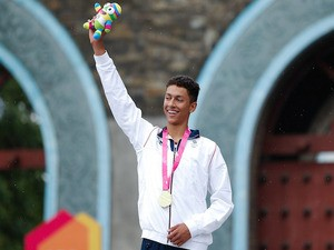 Gold medalist Ben Dijkstra of Great Britain celebrates during the medal ceremony in the Men's Triathlon on August 18, 2014