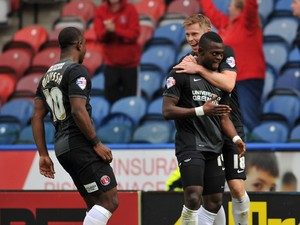 Igor Vetokele right and Simon Church of Charlton Athletic celebrate the 90th Minute goal during the Sky Bet Championship match between Huddersfield Town v Charlton Athletic at Galpharm Stadium on August 23, 2014