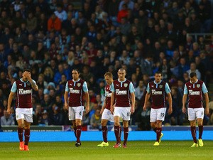 Danny Ings, Michael Duff, David Jones, Lukas Jutkiewicz and Dean Marney of Burnley look deejcted after conceding a third goal during the Barclays Premier League match against Chelsea on August 18, 2014