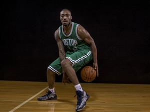 James Young #13 of the Boston Celtics poses for a portrait during the 2014 NBA rookie photo shoot at MSG Training Center on August 3, 2014