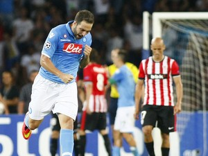 Napoli's Argentinian forward Gonzalo Higuain celebrates after scoring during the first leg of the UEFA Champions League play off football match between SSC Napoli and Bilbao Athletic Club in San Paolo Stadium on August 19, 2014