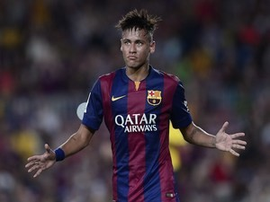 Barcelona's Brazilian forward Neymar celebrates his goal during the 49th Joan Gamper Trophy football match FC Barcelona vs Leon Club on August 18, 2014