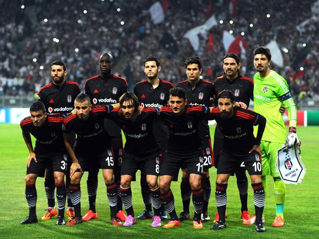 Besiktas' team players pose prior to the UEFA Champions League play-off football match Besiktas vs Arsenal at Ataturk Olympic Stadium on August 19, 2014
