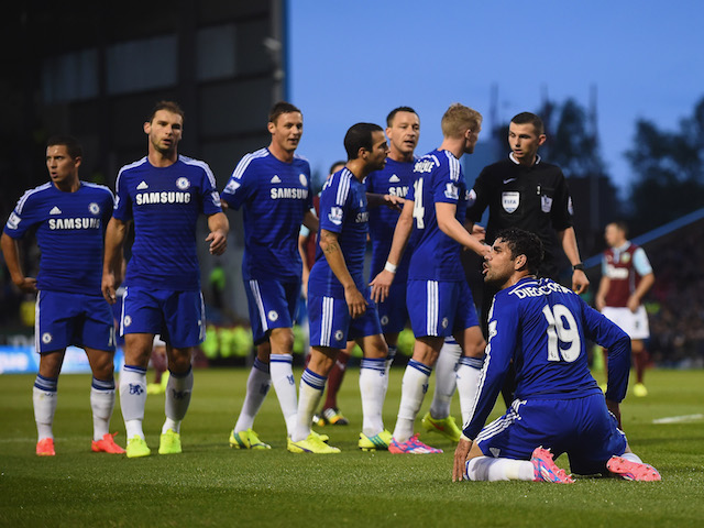 Chelsea players appeal to Referee Michael Oliver, as he books Diego Costa of Chelsea for diving during the Barclays Premier League match against Burnley on August 18, 2014