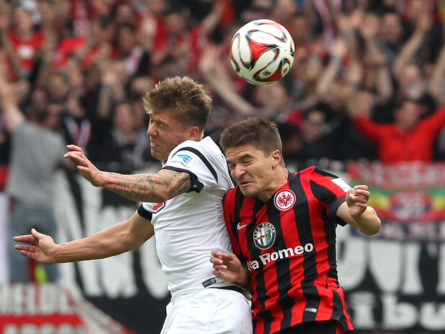 Frankfurt's Serbian defender Aleksander Ignjovski vies with Freiburg's midfielder Mike Frantz during the German first division Bundesliga football match Eintracht Frankfurt v SC Freiburg at Commerzbank-Arena in Frankfurt am Main, Germany on August 23, 201
