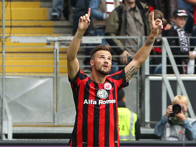 Frankfurt's Swiss forward Haris Seferovic celebrates scoring the 1-0 during the German first division Bundesliga football match Eintracht Frankfurt v SC Freiburg at Commerzbank-Arena in Frankfurt am Main, Germany on August 23, 2014