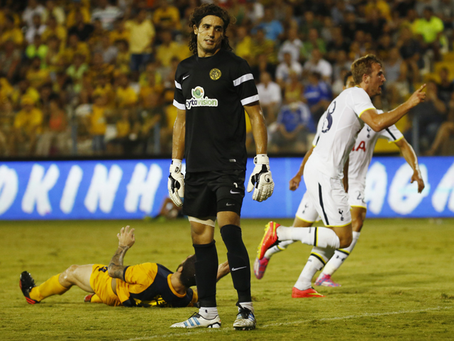 Harry Kane from Tottenham Hotspur celebrates a goal as Karim Fegrouch from AEL Limassol FC looks on during the AEL Limassol FC v Tottenham Hotspur - UEFA Europa League Qualifying Play-Off match on August 21, 2014