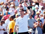 Andy Murray of Great Britain signs waves to fans after defeating Robin Haase of the Netherlands during his men's singles first round match on Day One of the 2014 US Open at the USTA Billie Jean King National Tennis Center on August 25, 2014