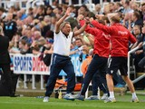 Manager Neil Warnock of Crystal Palace turns to celebrate with his coaching staff after Wilfried Zaha of Crystal Palace scored their third goal and equaliser in stoppage time during the Barclays Premier League match between Newcastle United and Crystal Pa