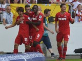 FC Koln's Japanese forward Yuya Osako, Austrian defender Kevin Wimmer, Nigerian forward Anthony Ujah and defender Jonas Hector celebrate after Osako scored the opening goal during the German first division Bundesliga football match VfB Stuttgart vs 1 FC K
