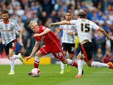 Mats Daehli of Cardiff City is challenged by Kay Voser of Fulham during the Sky Bet Championship match between Fulham and Cardiff City at Craven Cottage on August 30, 2014