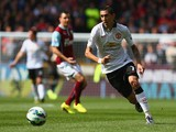 Angel di Maria of Manchester United runs with the ball during the Barclays Premier League match between Burnley and Manchester United at Turf Moor on August 30, 2014