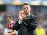 Manchester Uniteds Dutch manager Louis van Gaal applauds the fans as he leaves the pitch after the final whistle in the English Premier League football match between Burnley and Manchester United at Turf Moor in Burnley, north west England on August 30, 2