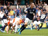 Shaun Williams of Millwall celebrates after Scott McDonald scored to make it 1-0 during the Sky Bet Championship match between Millwall and Blackpool at The Den on August 30, 2014