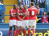 Henri Lansbury of Nottingham Forest celebrates with team mates after scoring the opening goal during the Sky Bet Championship match between Sheffield Wednesday and Nottingham Forest at Hillsborough Stadium on August 30, 2014