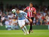 Jordan Mutch of QPR heads the ball under pressure from Jack Rodwell of Sunderland during the Barclays Premier League match between Queens Park Rangers and Sunderland at Loftus Road on August 30, 2014