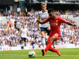 Raheem Sterling of Liverpool scores the opening goal during the Barclays Premier League match between Tottenham Hotspur and Liverpool at White Hart Lane on August 31, 2014