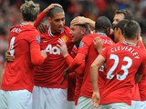 Manchester United's English striker Wayne Rooney (3rd L) celebrates with team-mates after scoring during the English Premier League football match against Arsenal on August 28, 2011