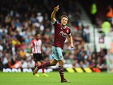 Mark Noble of West Ham United celebrates scoring his goal during the Barclays Premier League match between West Ham United and Southampton at Boleyn Ground on August 30, 2014