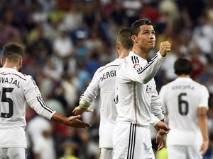 Cristiano Ronaldo celebrates scoring a last-minute goal for Real Madrid against Cordoba on August 25, 2014