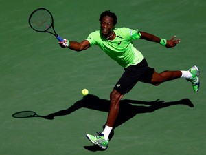 Gael Monfils of France returns a shot to Alejandro Gonzalez of Columbia during their men's singles second round match on Day Five of the 2014 US Open at the USTA Billie Jean King National Tennis Center on August 29, 2014