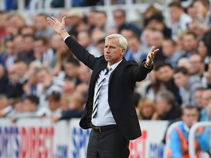 Alan Pardew, manager of Newcastle United gestures during the Barclays Premier League match between Newcastle United and Crystal Palace at St James' Park on August 30, 2014