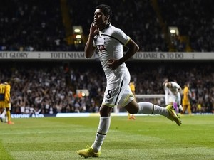 Tottenham Hotspur's Brazilian midfielder Paulinho celebrates scoring their second goal during the UEFA Europa League qualifying round play-off second-leg football match on August 28, 2014