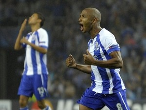 Porto's French-born Algerian midfielder Yacine Brahimi (R) celebrates after scoring a goal during the UEFA Champions League play-off game against Lille on August 26, 2014