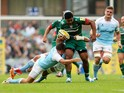 Manu Tuilagi of Leicester is tackled by Adam Powell (L) and Josh Furno (R) of Newcastle during the Aviva Premiership match on September 6, 2014