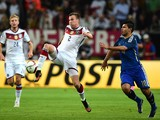 Argentina's striker Sergio Aguero vies with Germany's defender Kevin Grosskreutz during a friendly football match between Germany vs Argentina in Duesseldorf, Germany, on September 3, 2014
