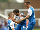 Marcus Maddison of Peterborough celebrates with Jack Payne and Jon Taylor after he scores to make it 1-0 during the Sky Bet League One match against Port Vale on September 6, 2014