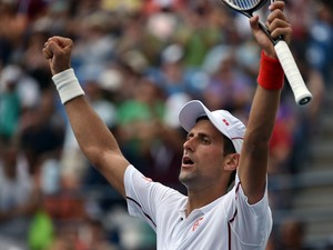 Novak Djokovic of Serbia celebrates his 6-1, 7-5, 6-4 win over Philipp Kohlschreiber of Germany during their 2014 US Open men's singles match at the USTA Billie Jean King National Tennis Center September 1, 2014