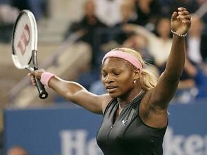 Serena Williams of the US raises her arms after defeating Venus Williams of the US during their women's final match at the US Open Tennis Tournament on September 7, 2002