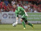 Alex Cisak of Burnley in action during the pre-season friendly between Accrington Stanley and Burnley at the Store First Stadium on July 26, 2014